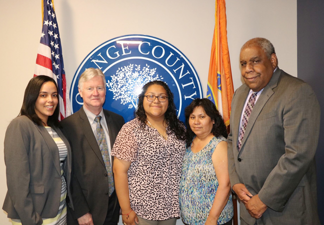 Inaudy Esposito, Executive Director of the Human Rights Commission, Deputy County Executive Harry Porr, Newburgh Free Academy senior Anita Sanchez Garcia, Sanchez Garcia's mom, Margarita Garcia, and Fred Cook, Chairman of the Human Rights Commission.