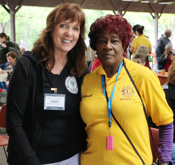 Office for the Aging Director AnnMarie Maglione with Hakimah al-Zahra of Warwick at the eighth annual Orange County Senior Health and Fitness Day at Thomas Bull Memorial Park in Montgomery on Wednesday, May 29th.