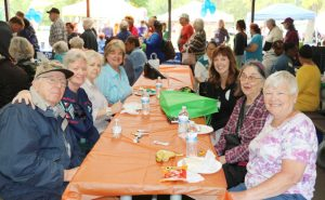 Maglione with a group of seniors at the eighth annual Orange County Senior Health and Fitness Day at Thomas Bull Memorial Park in Montgomery on Wednesday, May 29, 2019.