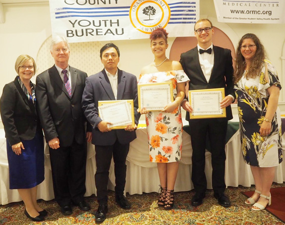 Lynn Tubbs, Youth Local Assistant Specialist with New York State Office of Children and Family Services; Deputy County Executive Harry Porr, Youth Board Advisory Board members Michael Torres, Cloe Fain, Ian Ackerman and Youth Bureau Director Rachel Wilson pose for a photo.