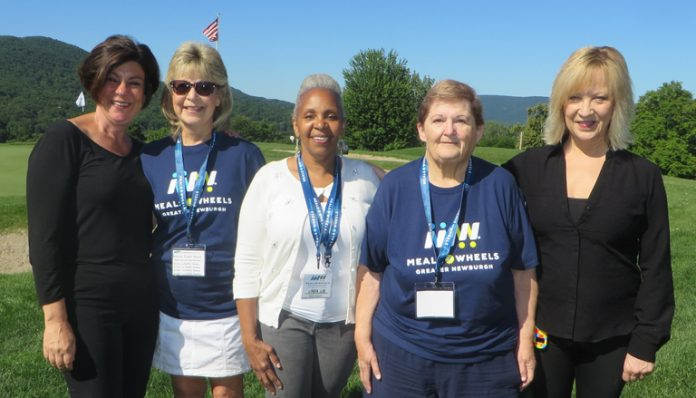 From left Angela Dorado, Linda Dirago, Linda Lewis-Burger, Faye Canfield, and Cindy Manpose for a photo during the Meals on Wheels tourney.