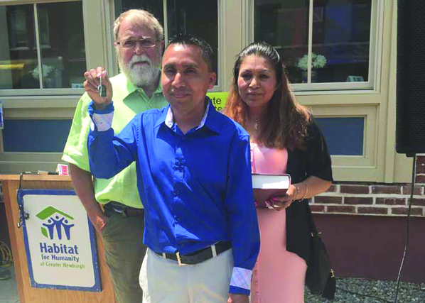 The Flores family receives the key to their new home from Habit for Humanity of Greater Newburgh.
