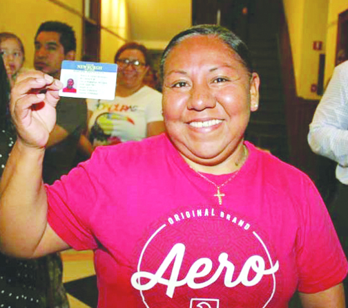 Blanco Flores proudly shows off her just-issued municipal ID card on the first day of issue, Tuesday, in the City of Newburgh.