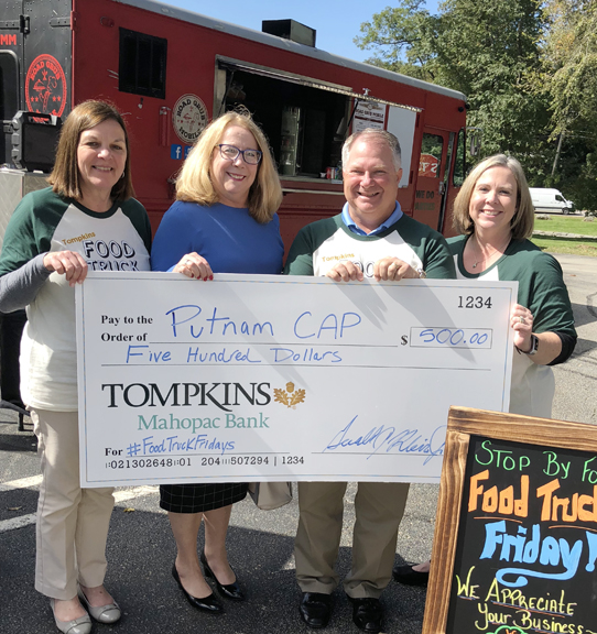 Food Truck Friday event in October 2018. From left to right: Carol Schmitz, TMB's SVP, branch administrator; Judy Callahan, executive director of Putnam CAP; Jerry Klein, TMB's president and CEO and Sue Musumeci, VP branch manager in Red Mills.
