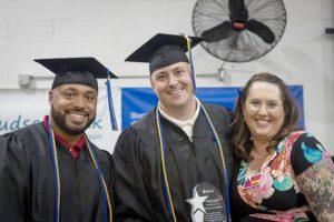 Hudson Link's Rachel Bernard (right) with valedictorian Douglas (center) and classmate Patrick (left).