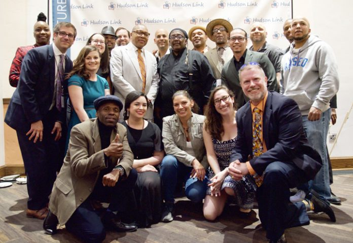 """Everyone say """"Jazz!"""": HL staff and alumni with Wynton Marsalis (center left)."""