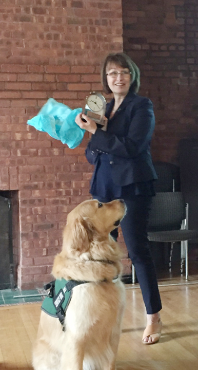 Kathy Peluso accepting the Award along with Courthouse Dog, Bosch.