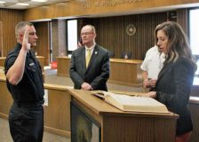 New Poughkeepsie Police Office Sean O'Keefe is administered the oath of office as Mayor Rob Rolison watches.