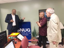 Pictured with Speaker Heastie (center) at the Poughkeepsie Family Partnership Center are SNUG Program Coordinator Danny Hairston and Assemblymember Jonathan Jacobson.