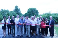 Barbara Martinez, Executive Director of the Goshen Chamber of Commerce, Orange County Deputy Commissioner of Public Works Travis Ewald, Chairman of the Legislature Steve Brescia, Legislator James O'Donnell, Parks Commissioner Jim Brooks, County Executive Steven M. Neuhaus, Legislator Michael Paduch, Town of Goshen Supervisor Doug Bloomfield, Tourism Coordinator Stephanie Kistner, Tourism Assistant Jiana Barker and Deputy County Executive Harry Porr at the ceremonial ribbon cutting to celebrate the completion of construction on the Heritage Trail, extending it approximately 2.2 miles from the Village of Goshen to the Town of Goshen. (Second row, from left to right) Deputy Commissioner of Parks Michael Amodio, Legislator Joel Sierra, Legislator John Vero, Legislator Rob Sassi and Legislator Barry Cheney.