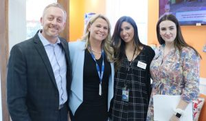Orange County Economic Development Director Bill Fioravanti, Tourism Director Amana Dana, Tourism Director Stephanie Kistner and Tourism Intern Isabelle Frank at the grand opening of the Orange County Tourism Office's Welcome Center.