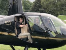 Golfers at the 2018 outing; Evan Hathaway, flight student, from Gardiner, NY, prepares for the helicopter ball drop with Heather Howley, of Independent Helicopters.
