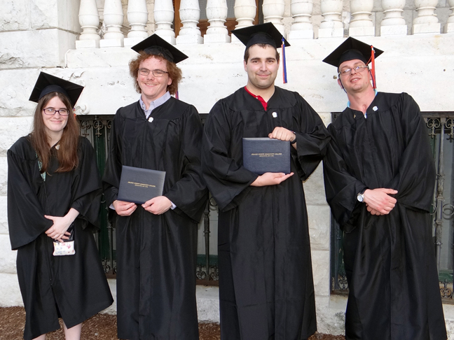 This past May, SUNY Orange recognized the first group of students to complete their programmatic requirements while enrolled in the BRIDGES program. The students, who participated in the College's Commencement ceremony, were, from left: Brynn Sutter, Martin Anderson, Thomas Ribaudo and Brian McKeeby. The BRIDGES program provides an inclusive, community-based educational framework for students with intellectual disabilities (ID), developmental disabilities (DD) or autism spectrum disabilities (ASD).