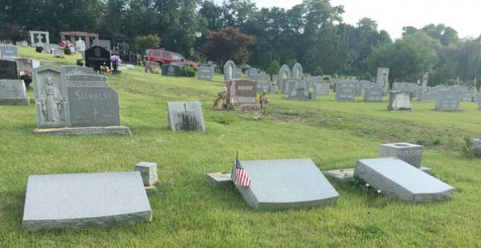 Town Police in New Windsor are investigating damage to close to 100 headstones from gravesites and damage to several other items on the property to Calvary Cemetery in the intersection of Routes 9W and 94.