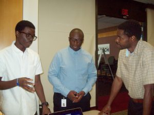 From left are Robinson Denis, a fifth year NFA P-TECH student and Octavius Fryar, a fourth year NFA P-TECH student, two of the 37 summer interns who worked on high tech solution projects during their six week experience. Last Thursday, they all presented their findings to their managers and senior leaders.