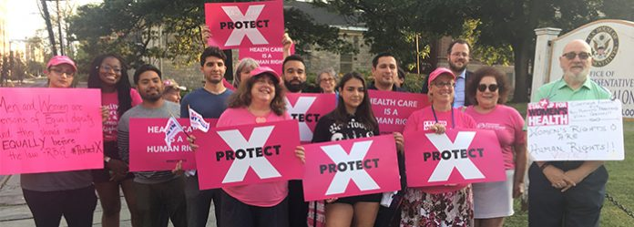 A group of volunteers and supporters of Planned Parenthood of the Mid-Hudson Valley gathered Wednesday evening to protest the Trump administration's recent gag rule forcing the family planning provider out of Title X.
