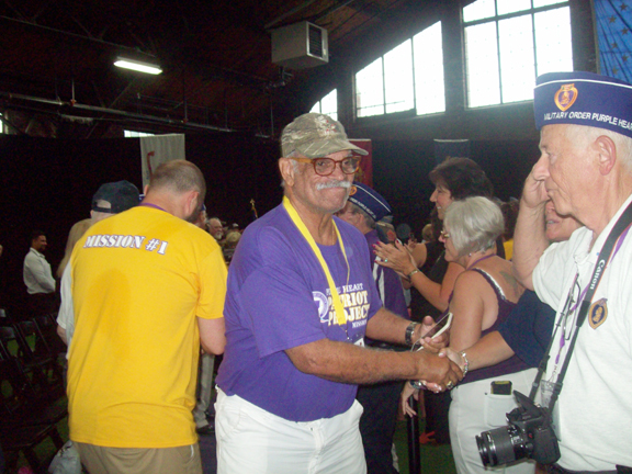 Army veteran, Seargent John Wambi Cook of California, was one of 33 recipients honored for their prestigious Purple Heart, as part of the National Purple Heart Day festivities that were celebrated at the City of Newburgh's Armory Unity Center last Wednesday night.