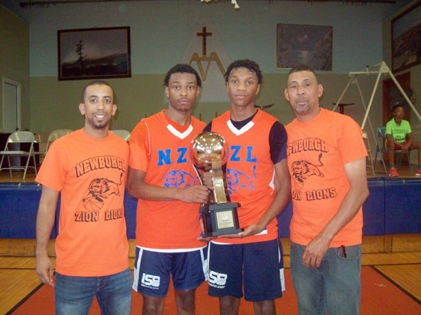 Brian Smith, Head Coach of Newburgh Zion Lions 17U; players Jaden Shelby, NFA senior; Percy Smith, NFA Class of 2019 graduate; and Harold Rayford, Director of Newburgh Zion Lions as well as 17U Assistant Coach. The team recently captured a prestigious second place showing at the AAU National Basketball Championships, held at Disney's ESPN Wide World of Sports. Part of a talented 32 team pool. the Newburgh squad tallied an impressive 8-1 tournament record, playing very well while bonding as a cohesive unit and learning many life skills and lessons throughout the season.