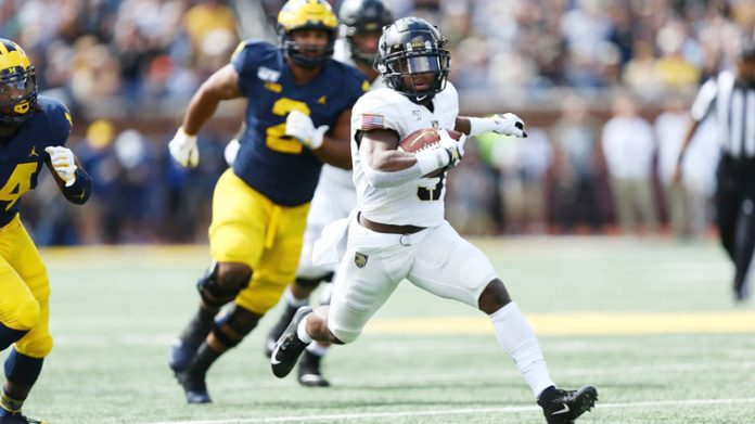 Army West Point quarterback Kelvin Hopkins Jr. ran for 41 yards and two touchdowns in the loss against Michigan. Photo: Danny Wild