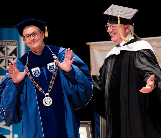 Dr. Jason N. Adsit (left), seventh president of Mount Saint Mary College, receives the college's ceremonial mace from past president Dr. David A. Kennett (right) and English professor James Finn Cotter (center). Photo: Lee Ferris