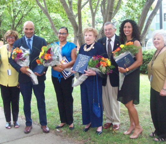 """Five Newburgh community members were honored at last Wednesday's """"Ring the Bell"""" Celebration, kicking off the new school year at the Newburgh Enlarged City School District. Pictured are the five honorees along with some of their family members and Newburgh Enlarged City School District Board of Education members."""