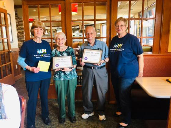 Meals on Wheels of Greater Newburgh President Carole McDermott, left, and Executive Director Robin Bello, right, flank honorees Fran and Lenny DeRobertis at the recent luncheon honoring the couple for their decades of volunteer work for the organization.