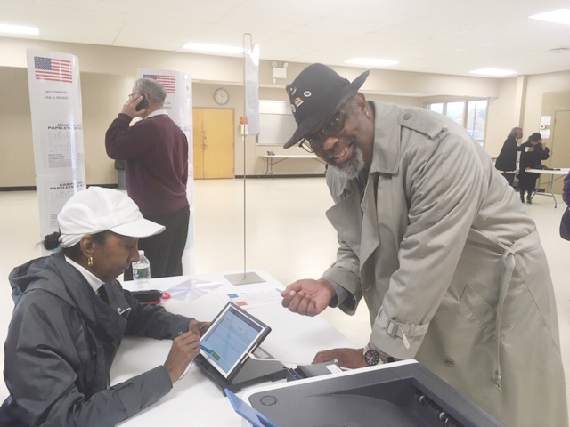 Town of Newburgh's Ike Broome shows his excitement to cast his vote early last Sunday at the Newburgh Activity Center.