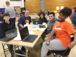 One of several teams competing in the AT&T Hackathon, held at Mount Saint Mary College was Newburgh Free Academy P-TECH Members working on the public transportation challenges their city faces. From left are; junior Jacob Johnston, volunteer Patrick Stephenson and  sophomores Israel Pagan, Kevin Leto, and Zoe Graves.