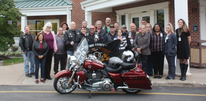 Orange County Harley Owner's Group presents check to the Littman Cancer Center Team.