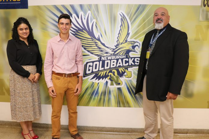 George Eliadis (center) is photographed with guidance counselor Ms. Juana Rivera (left) and principal Mr. Raul Rodriguez (right).
