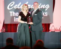 President and CEO Bill Calderara of Ulster Savings Bank (right) receives the BanksGiving™ Banky® Award from Roxanne Emmerich, founder and chair, The Institute for Extraordinary Banking (left), at the 2019 Extraordinary Banking Awards Ceremony.