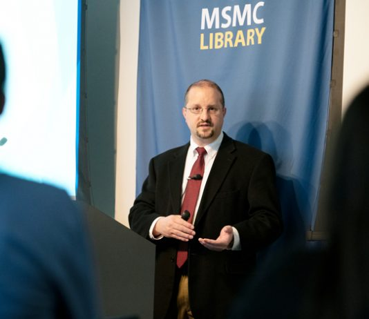 Michael L. Fox, assistant professor of Business Law and the college's Pre-Law advisor at Mount Saint Mary College, discusses human rights laws at his recent talk. Photo: Lee Ferris
