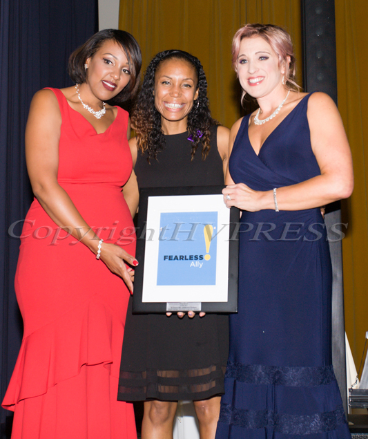Serita Green, left, and Kellyann Kostyal-Larrier, right, present Kristen Feden Gibbons, center, with an award during the Fearless! (Safe Homes of Orange County) 33rd Anniversary and Celebration of Hope Gala on Friday, October 25, 2019. Hudson Valley Press/CHUCK STEWART, JR.
