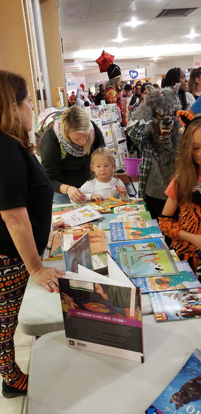 With rainy weather this year, many families in the area took to the Newburgh Mall to trick or treat indoors. The Newburgh Free Library participated in this year's Halloween event at the Newburgh Free Mall giving out books, as well as candy to families.