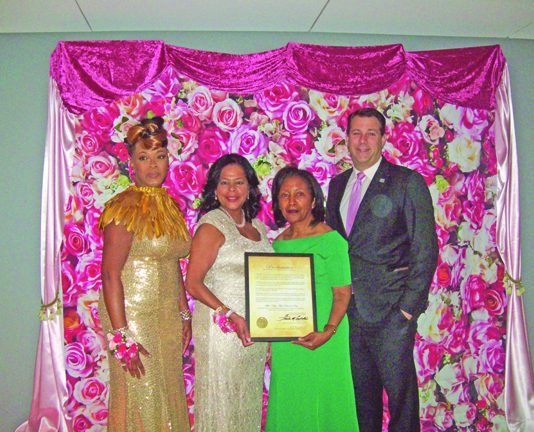 """On Saturday evening, the Alpha Kappa Alpha Sorority, Inc. Iota Alpha Omega Chapter & Mid-Hudson Ivy Foundation, Inc. hosted its 50th Anniversary Gala, """"An Evening of Elegance & Excellence,"""" at Eisenhower Hall Theater at West Point. From left are: Mrs. Sonya D. Fiol-Grant, Iota Alpha Omega Chapter President; Mrs. Marie Price, 50th Anniversary Gala Vice-Chairperson; Mrs. Celestine Campbell, 50th Anniversary Gala Vice-Chairperson, and Mr. Frank M. Castella, Jr., President Dutchess County Regional Chamber of Commerce."""