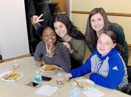 """Volunteers from Mount Saint Mary College's Big Brothers Big Sisters club provided a Thanksgiving meal to area """"Littles"""" earlier this month."""