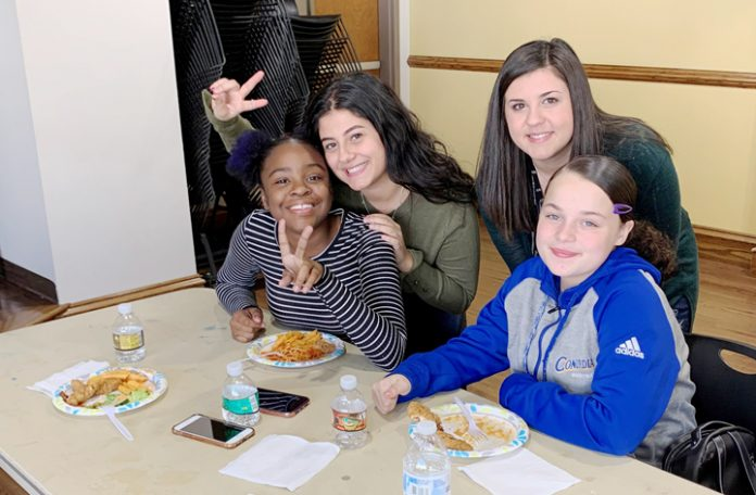 "Volunteers from Mount Saint Mary College's Big Brothers Big Sisters club provided a Thanksgiving meal to area ""Littles"" earlier this month."