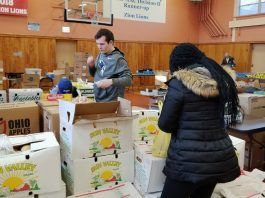 Mount Saint Mary College students help distribute hundreds of pounds of food on Friday, November 15 to those in need through Newburgh's St. Mary's Church.