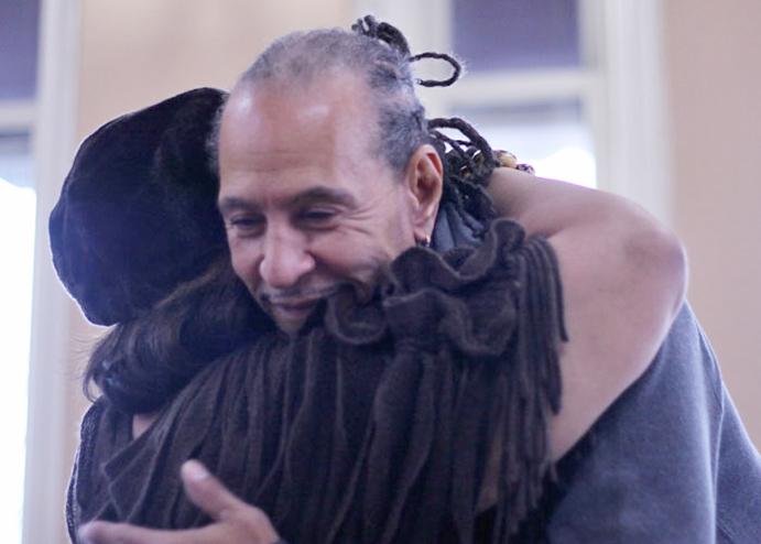 Omari Shakur gets a hug from his mother, Lillie Howard.
