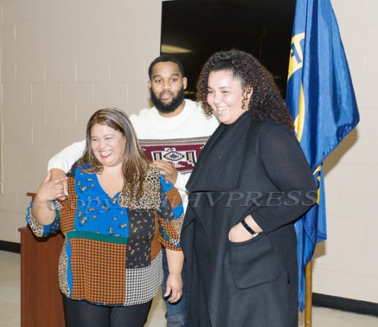 Maritza Wilson (left) poses for a photo with two of her children Matthew (center), and Mirna (right) while being honored at the Newburgh Activity Center, with a prestigious State Commendation Award. Hudson Valley Press/CHUCK STEWART JR.