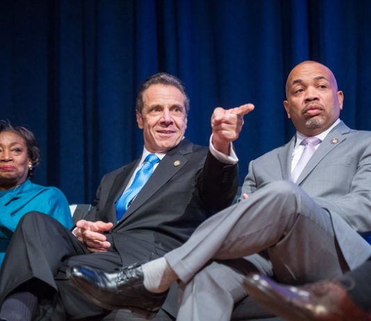 New York State Senate Majority Leader Andrea Stewart-Cousins, Governor Andrew Cuomo and Speaker Carl E. Heastie share a moment during the 2020 State of the State address.