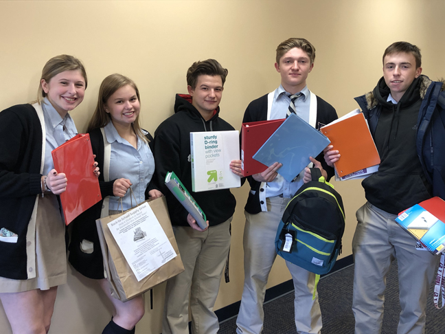 Members of John S. Burke Catholic High School's football and volleyball teams coordinated a school supply drive to benefit Catholic Charities of Orange, Sullivan, and Ulster. Team members Caitlin McCartney, Elizabeth Magnussen, Chris Anastasis, Daniel Weslowski, and Brendan Tierney delivered the supplies to Catholic Charities' Goshen office. They will be distributed to children of families served by the non-profit agency.