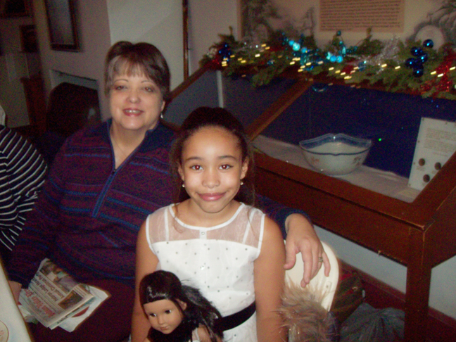 Leticia Hixon of Stormville enjoys last Monday's Annual Mount Gulian Holiday Tea-for both adults and their children/grandchildren-family members- with her just turned 9 year old granddaughter, Sera Smith. In total, Hixon, who has been attending the popular Tea since 2008, has taken three of her granddaughters to the event that introduces children to a popular tea tradition of times past, good manners, a taste of history, along with opportunity to make a craft and enjoy plenty of delicious food.