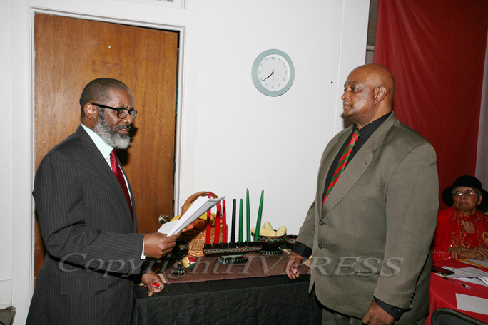 Bishop Dorsey and Donald Fryar lead the Kwanzaa Candle Ceremony & Zawadi during the Black History Committee of the Hudson Valley Annual Kwanzaa Celebration on Sunday, December 29, 2019 at Mt. Calvary Fire Baptized Church in Newburgh, NY. Hudson Valley Press/CHUCK STEWART, JR.