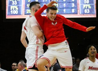 Tyler Sagl and Ryan Carmello celebrate after their 83-73 home victory over Iona.