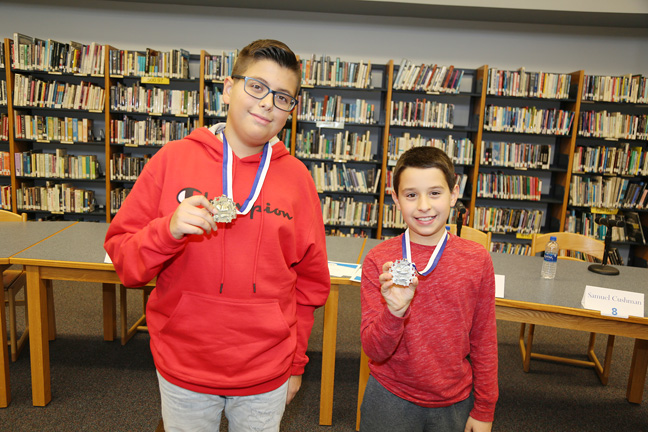 Samuel Cushman, a Grade 8 Jr. High School student (left), and Pierce Tierney, a Grade 5 Riccardi Elementary School student proudly display their medals after taking first and second place in the Saugerties Central School District Annual Spelling Bee.