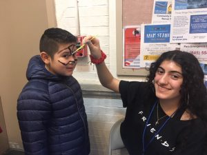 Face painting was one of several fun offerings at Saturday's Three Kings Day Celebration. Volunteer, Adriana Liberti, a Roy C. Ketcham Sophomore paints an image on City of Poughkeepsie's Cristinn Del Moral, age 10.