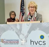 Andrea Straus, executive director of Hudson Valley Community Services discusses the merger while Cornerstone President Linda Muller listens.