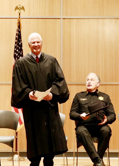 Orange County Supreme Court Justice Robert Onofry addresses the audience at the County's naturalization ceremony on Wednesday, February 19th with Sheriff Carl E. DuBois looking on.