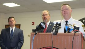 Port Jervis Police Chief William Worden discusses details of the case while Mayor Kelly Decker, left, and District Attorney David Hoovler, listen.
